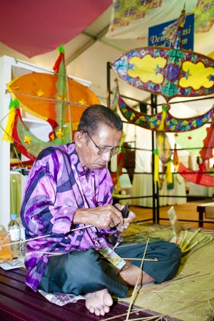 KUALA LUMPUR, MALAYSIA - MARCH 4: Shafie Jusuh, a traditional Wau Bulan (Kite) maker doing a demostration at the Malaysia Nation at the Malaysia National Craft Day 2011 on March 4, 2011 in Kuala Lumpur, Malaysia. Stock Photo - 9433976