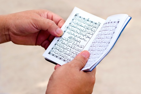 Man Reading Yassin From The Islamic Holy Quran  photo