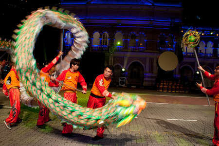 KUALA LUMPUR, MALAYSIA-MAY 20:Participant from the Chinese community performing a dragon dance at the rehearsal of Colours of 1 Malaysia Festival May 20 2011 in Kuala Lumpur Malaysia.This event is a symbol of unity and diversity for all races and religion Stock Photo - 9561673
