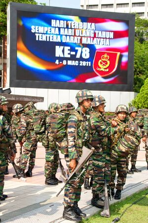KUALA LUMPUR, MALAYSIA-MAR 5: The Royal Malay Regiment  getting ready at the 78th Army Anniversary on Mar 5, 2011 in Kuala Lumpur, Malaysia. Malaysia spends 1.9 percent of its GDP on military.