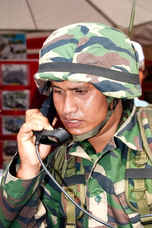 KUALA LUMPUR, MALAYSIA-MAR 5:Unidentified soldier with a communication device at the 78th Army Anniversary Celebrations on Mar 5, 2011 in Kuala Lumpur, Malaysia. Malaysia spends 1.9 percent of its GDP on military.