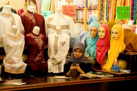 identified: BANDUNG-JUNE 26:Unidentified women at Pasar Baru Trade Centre selling islamic fashion on June 26, 2011 in Bandung, Indonesia. Islam is the dominant religion in Indonesia, with approximately 202.9 million identified as Muslim. Editorial