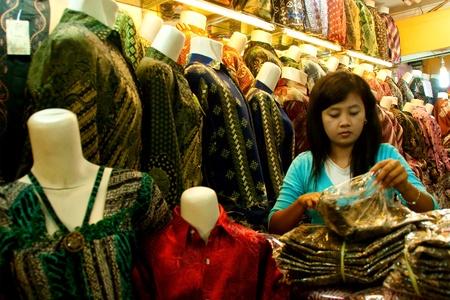 BANDUNG-JUNE 26 : Unidentified batik sellers at Pasar Baru Trade Centre prepare for customer on June 26, 2011 in Bandung, Indonesia. In 2009 UNESCO recognized batik as an Indonesian cultural treasure.