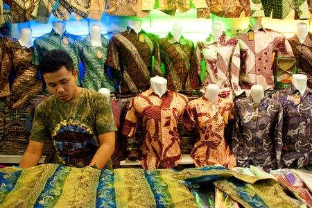 BANDUNG-JUNE 27 : Unidentified batik sellers at Pasar Baru Trade Centre prepare for customer on June 27, 2011 in Bandung, Indonesia. In 2009 UNESCO recognized batik as an Indonesian cultural treasure. Editorial