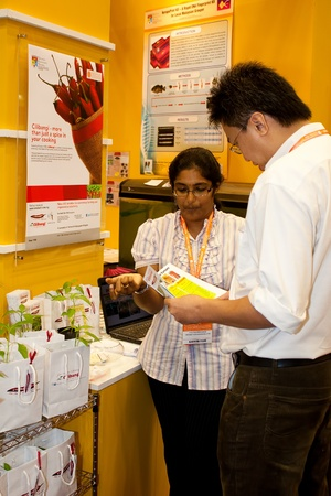 KUALA LUMPUR-NOV 22: Unidentified exhibitor explaining the CiliBangi an agriculture bio product to investor at the BioMalaysia 2011 Exhibition on November 22, 2011 in Kuala Lumpur, Malaysia.