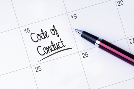 work ethic responsibilities: The words Code of Conduct written on a calendar