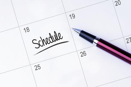 De woorden Schema op een kalender geschreven Stockfoto