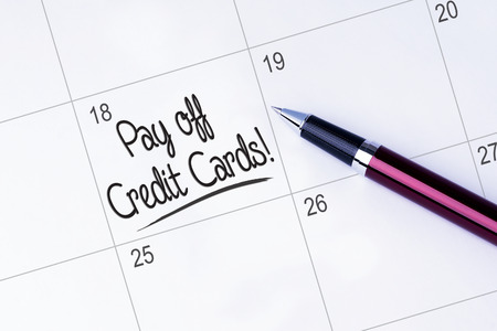 pay off: The words Pay off Credit Cards written on a calendar Stock Photo