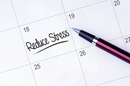 elimination: The words Reduce Stress written on a calendar