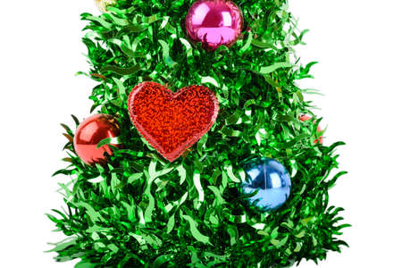 Christmas tree with decorations and heart isolated on white background, green and bright photo