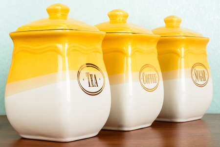 Ceramic jars of coffee, tea and sugar, isolated on white background Stock Photo