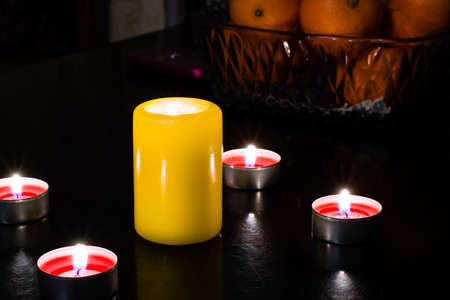 suppository: An arrangement of scented candles on the table in the evening for dinner Stock Photo