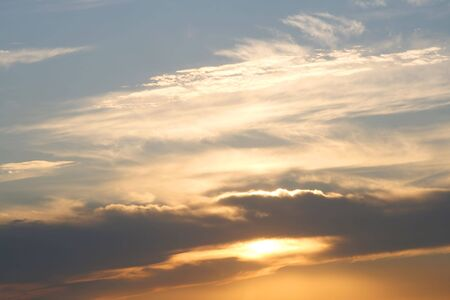 evening sky with clouds and sun photo