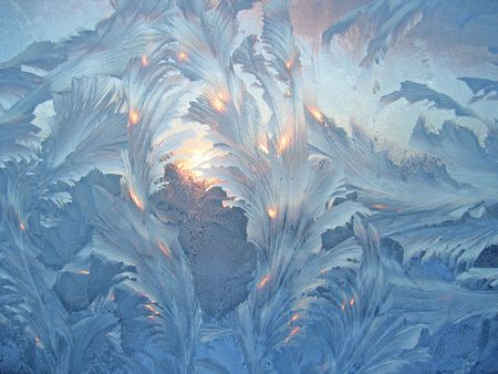 frosted glass: Frosty natural pattern and sun.on winter window