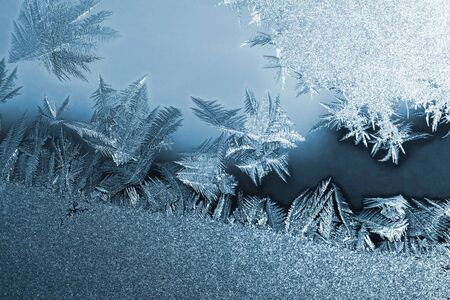 crystallization: Frost icy flowers on a glass