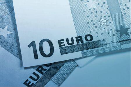 euromoney: euro money blue background Stock Photo
