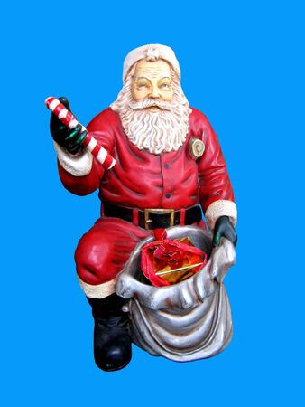 Christmas statue of Santa Claus isolated on the blue background photo