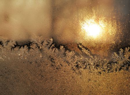 Frost and sun on winter window  photo