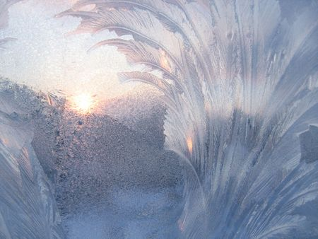 frosted glass: frost and sun on winter window