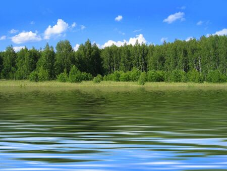 summer landscape with bright blue sky and trees reflected in water Stock Photo - 6661450