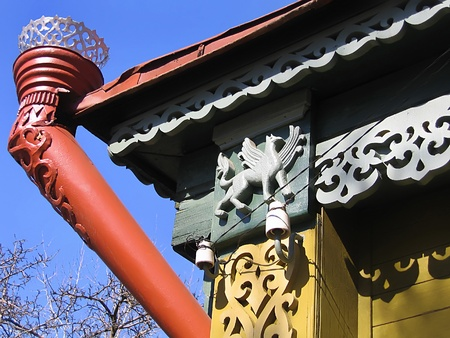 Fragment of a old Russian house with decorative carvings and rain gutter. Shot taken in Kolomna - provincial Russian town photo