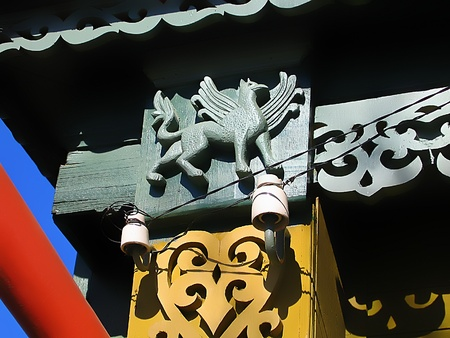 Fragment of a old Russian house with decorative carvings and the figure of a griffin. Shot taken in Kolomna - provincial russian town photo