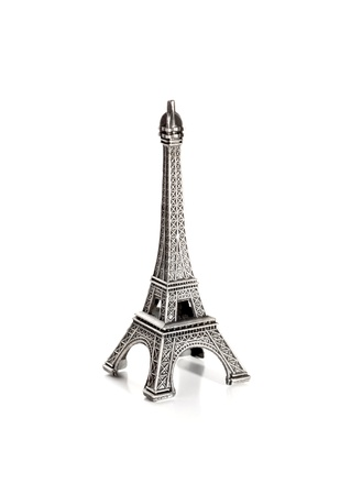 small copy of eiffel tower on white baclground photo