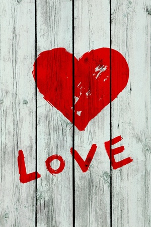 heart on wooden wall photo