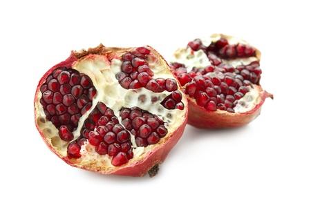 tasty pomegranate fruit on white background photo