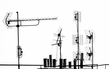 television antennas and pipes on the rooftop Stock Photo