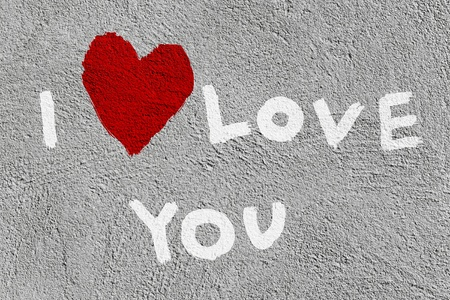 inscription I love you with abstract heart on the concrete wall Stock Photo - 9905554