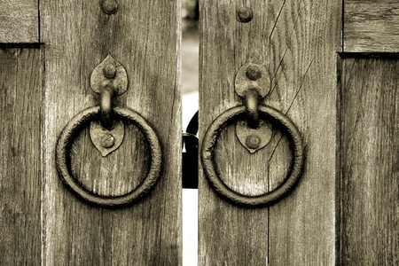 door knob: ancient wooden gate Stock Photo
