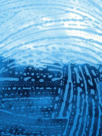 soap foam bubbles on the glass                                photo