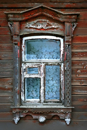 window of very old wooden russian house