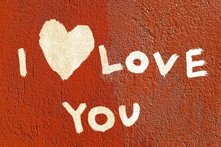 inscription I love you with abstract heart on the paint wall photo