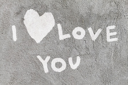 declaration of love: inscription I love you with abstract heart on the concrete wall