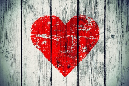 love symbol on old wooden wall background Stock Photo