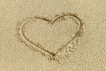 Heart drawing in the sand photo