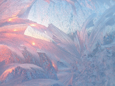 ice patterns and morning sunlight on winter glass photo