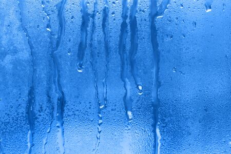natural water drop on the glass photo