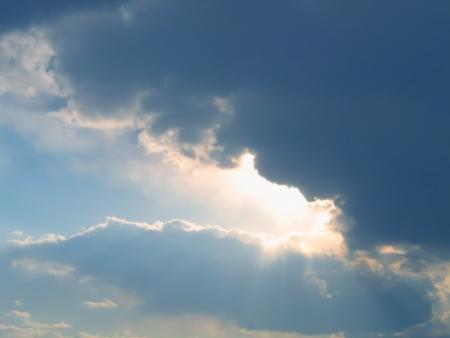 rain cloud and rays of sunlight