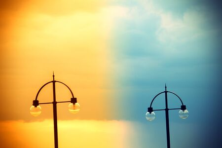 streetlamp: Two street lamps on abstract evening sky Stock Photo