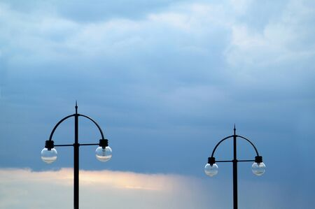 streetlamp: Two street lamps on evening sky Stock Photo