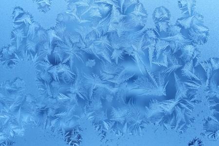 Ice pattern on winter glass photo