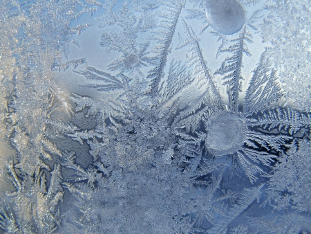rime frost: Frosty pattern on winter window Stock Photo