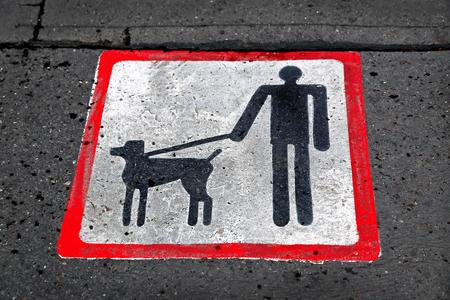 hygene: Dog walking sign on road