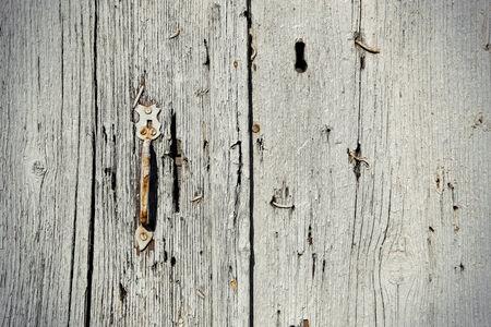 Vintage wooden door texture with handle photo