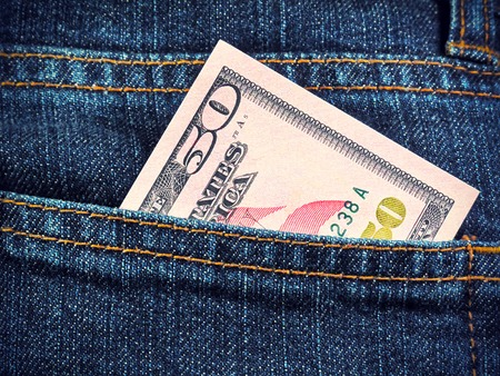 Money in the pocket of blue jeans  photo
