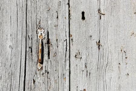 Very old wooden door texture with handle photo