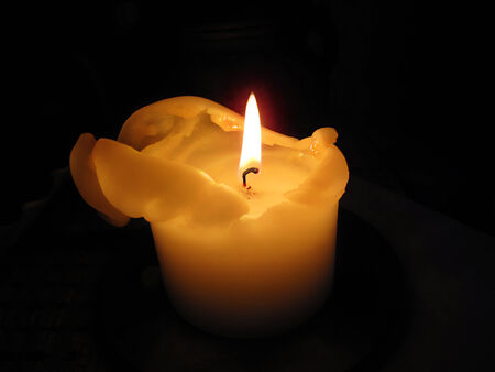 brigt: Brigt candle burning in the dark